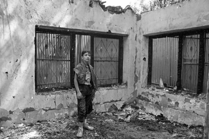 (A boy inside a house destroyed during an encounter in Pinjura village of Shopian in South Kashmir on June 8, 2020. Two houses were completely damaged during a counter-insurgency operation that resulted in the killing of four militants.) Picture: Kamran Yousuf/NewsClick