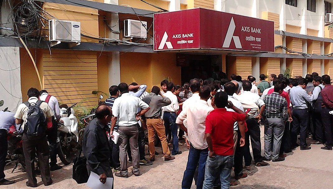 People Standing in Queue for Depositing and Exchanging Currency.