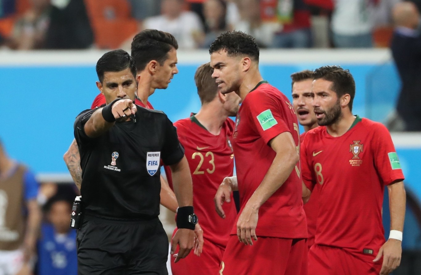 VAR penalty decision during Iran vs Portugal FIFA World Cup match.