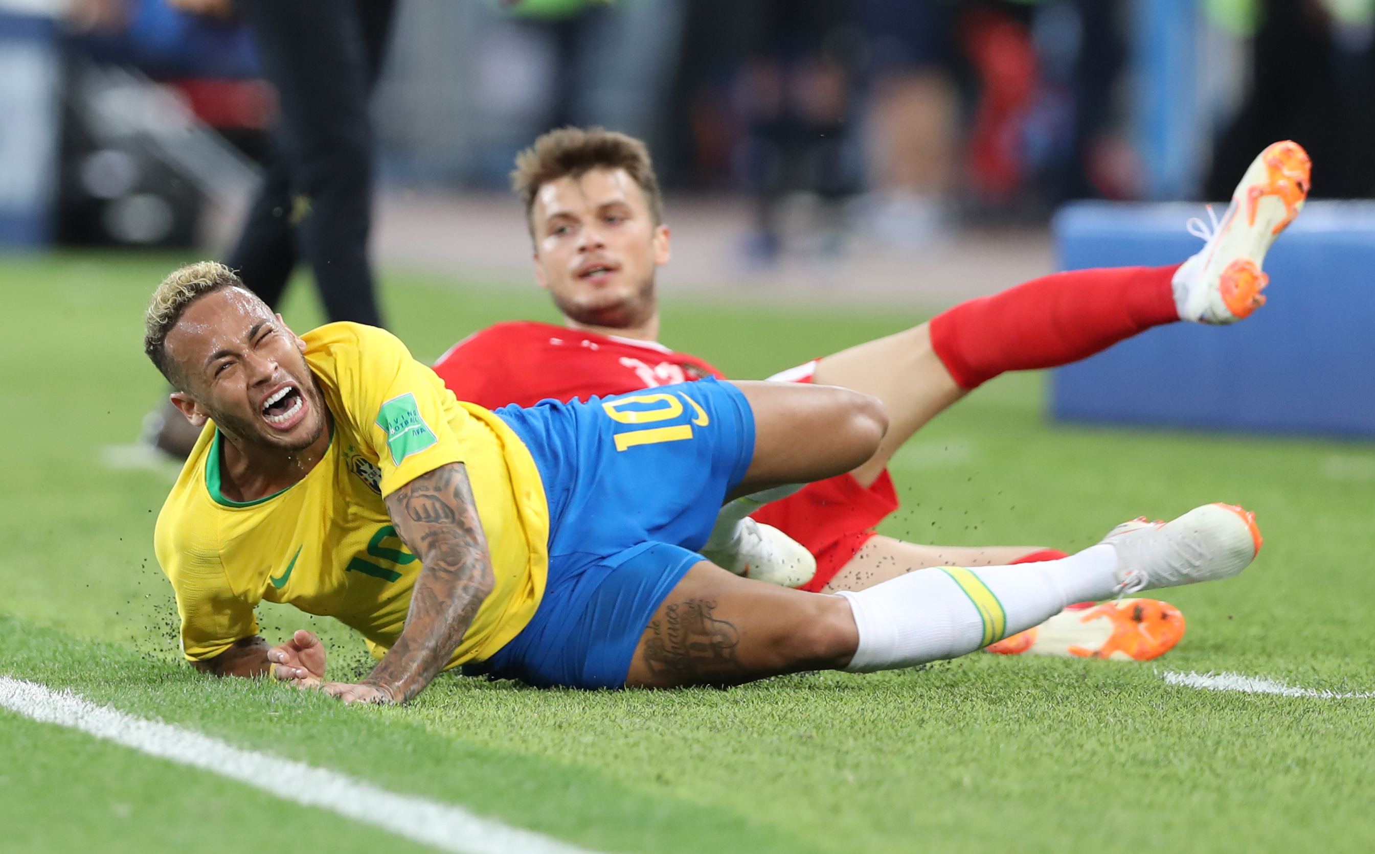 Neymar of Brazil football team gets fouled at FIFA World Cup.