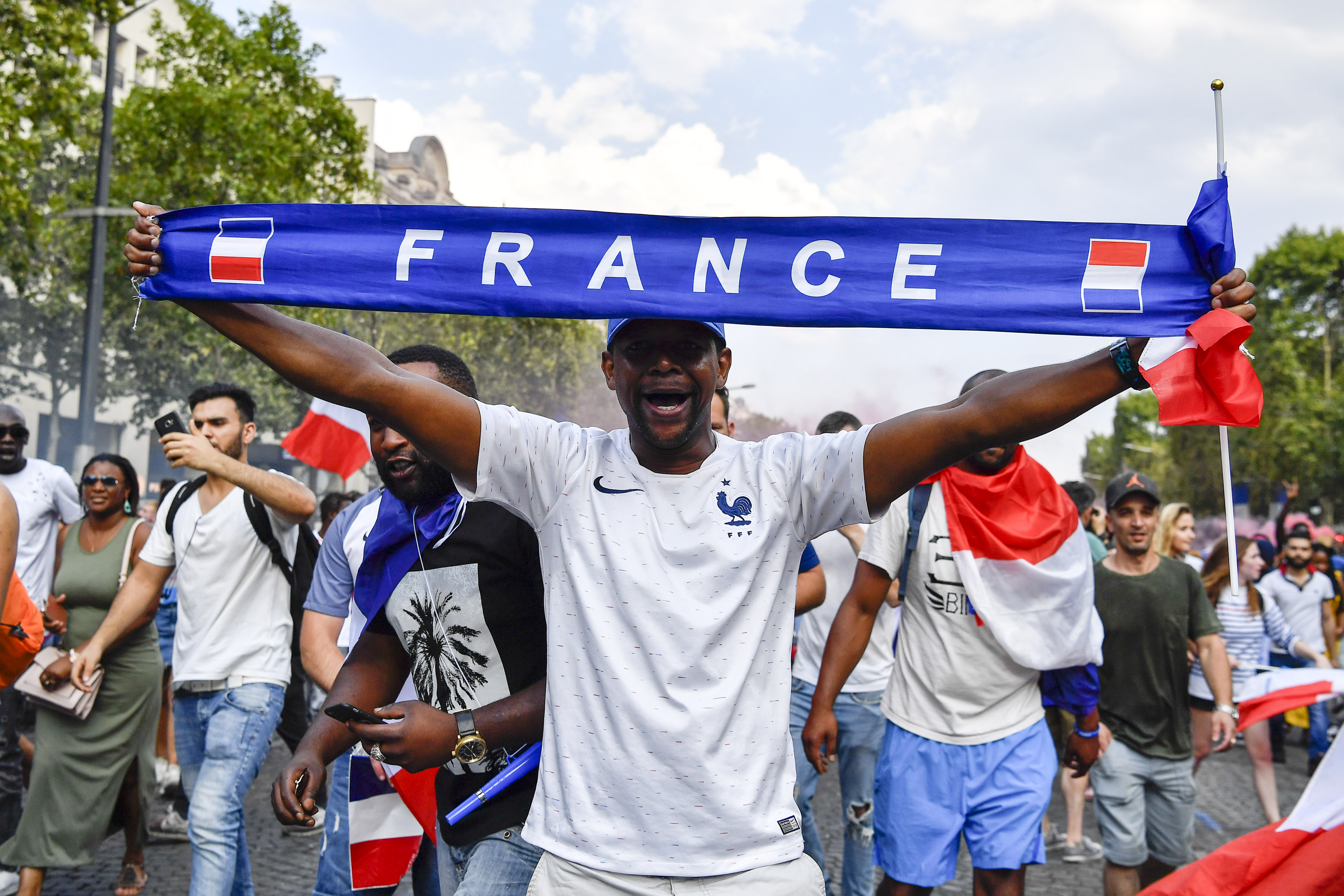 French football fan at Champs-Élysées in Paris