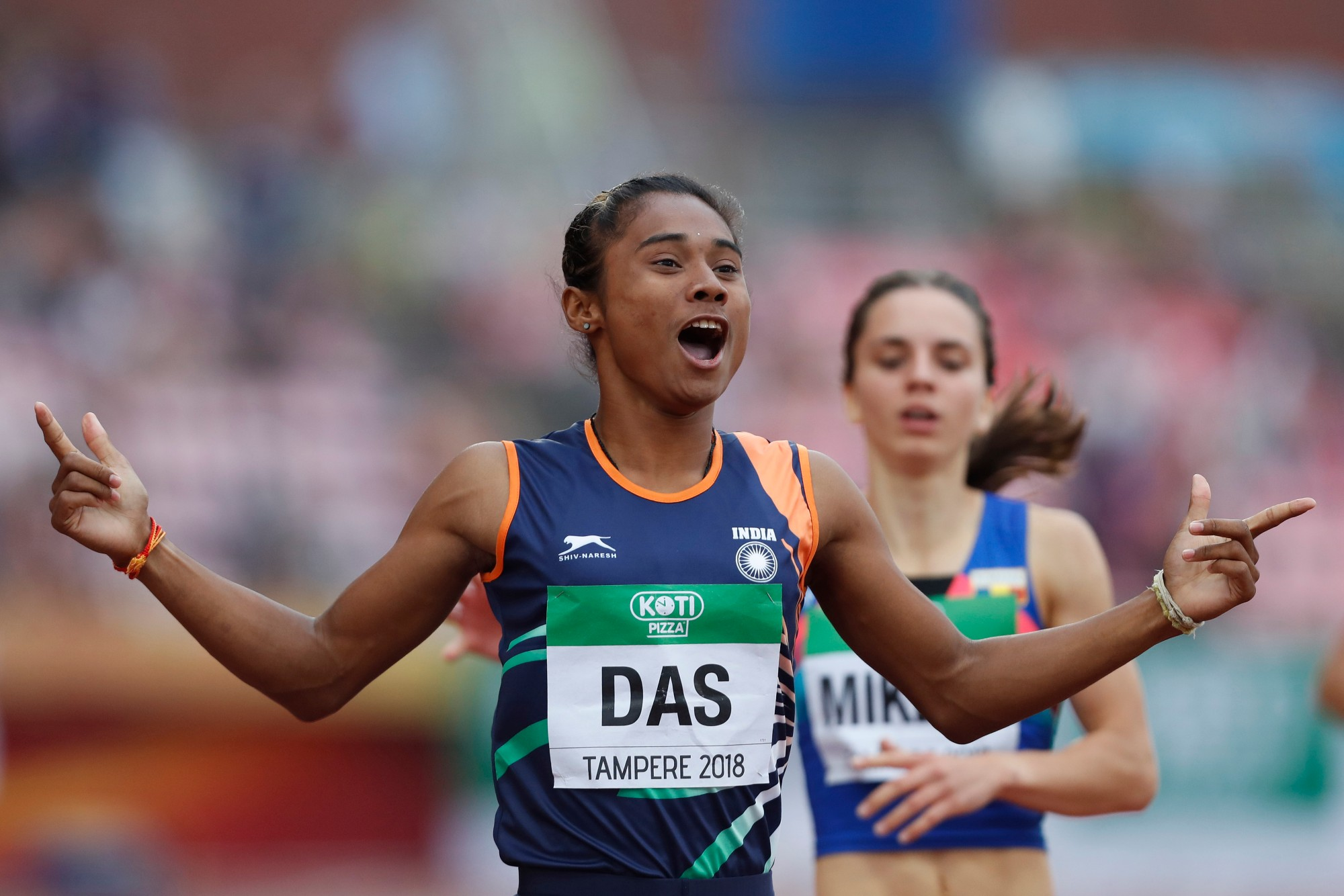 Hima Das of India wins gold medal