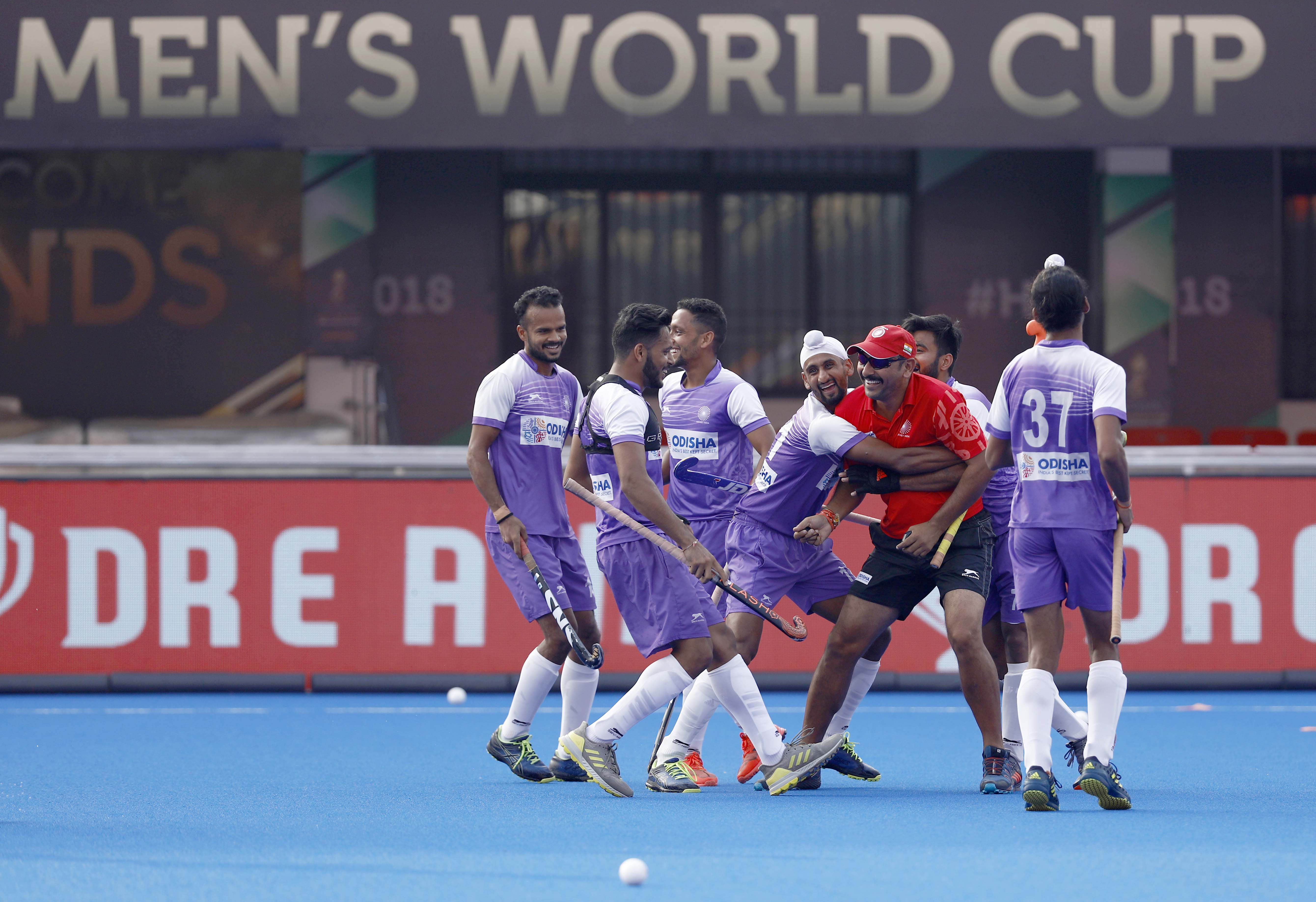 Indian men's hockey team players with coach Harendra Singh