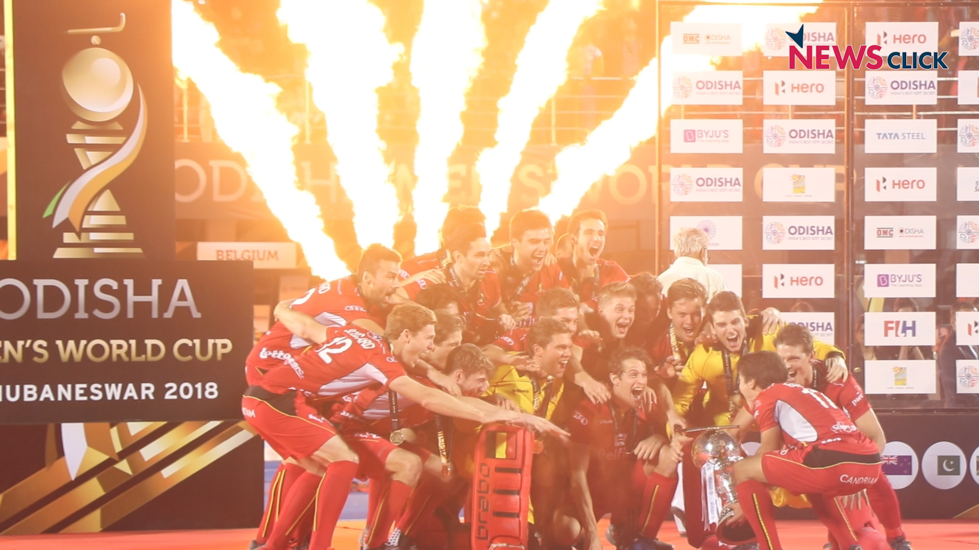 Belgium hockey team players celebrate after winning the FIH Men's Hockey World Cup