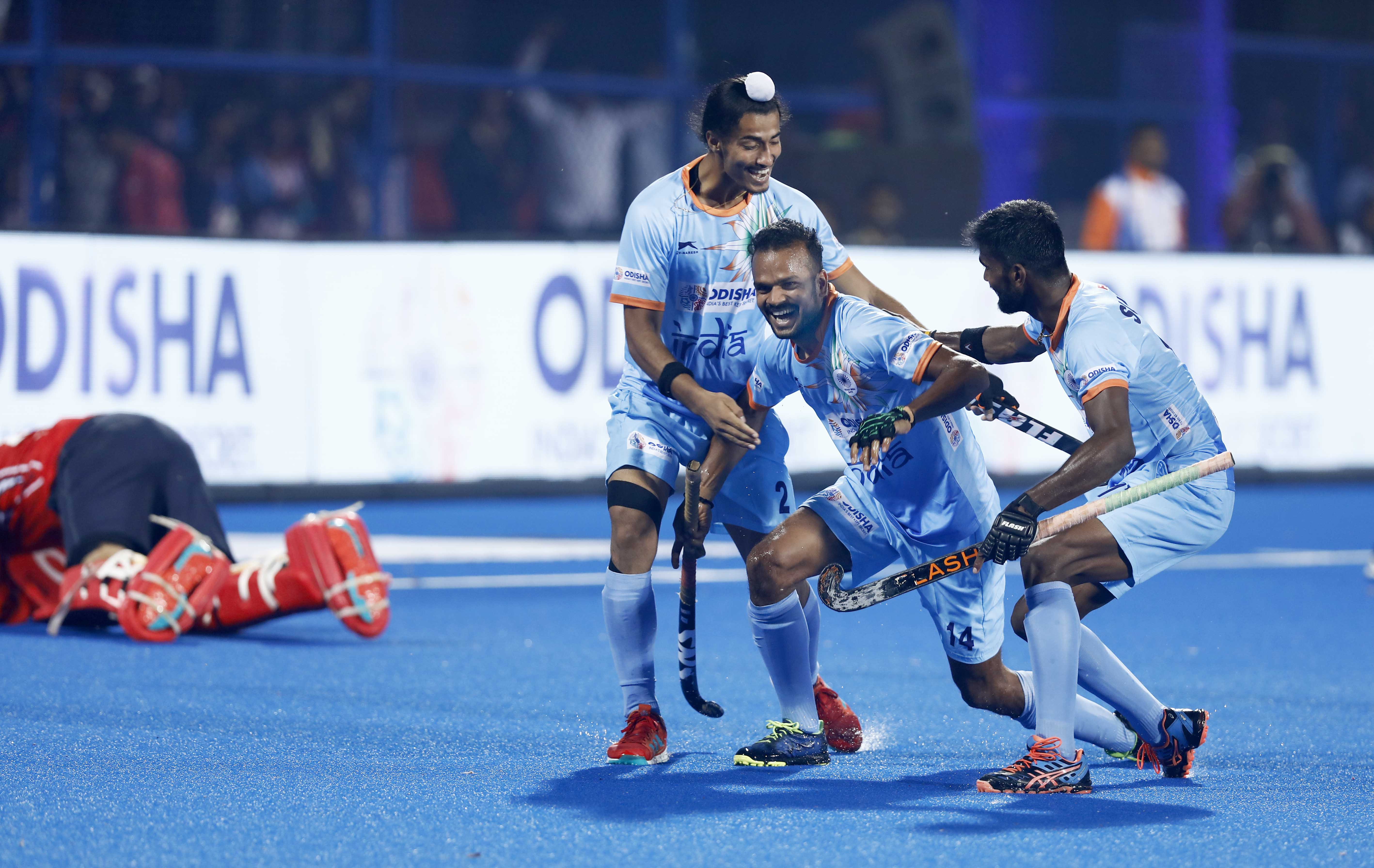 Indian hockey team players celebrate in the match against South Africa a the FIH Men's Hockey World Cup