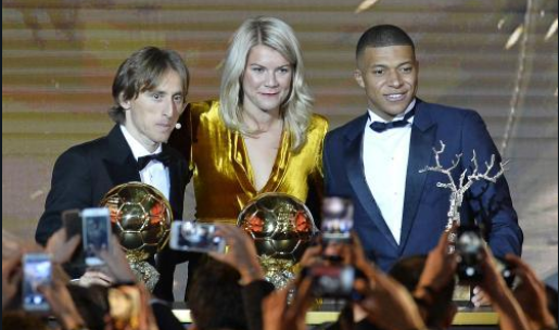 Luka Modric, Ada Hegerberg and Kylian Mbappe at the Ballon D'Or awards ceremony