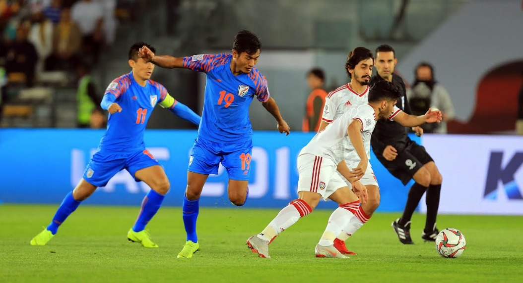 Indian football team players vie for the ball with UAE players at AFC Asian Cup