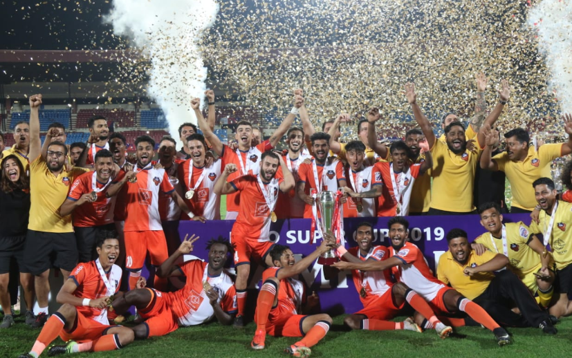 FC Goa players celebrate at the podium after winning the 2019 Hero Super Cup in Bhubaneswar