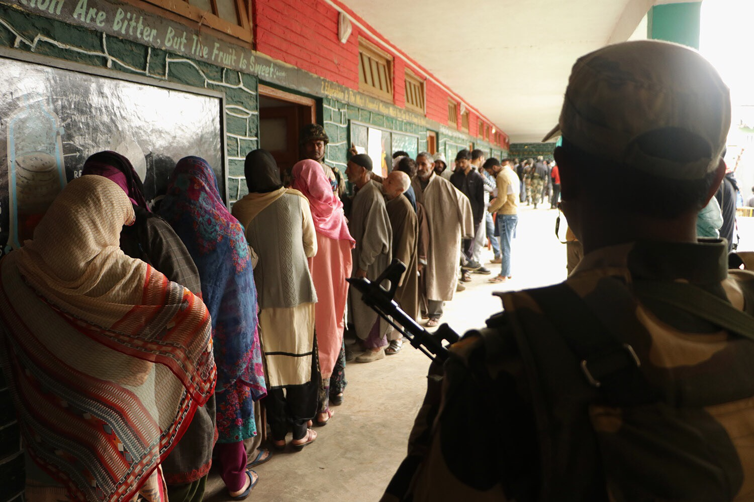 Voters waiting for their turn to cast their vote at Handwara.