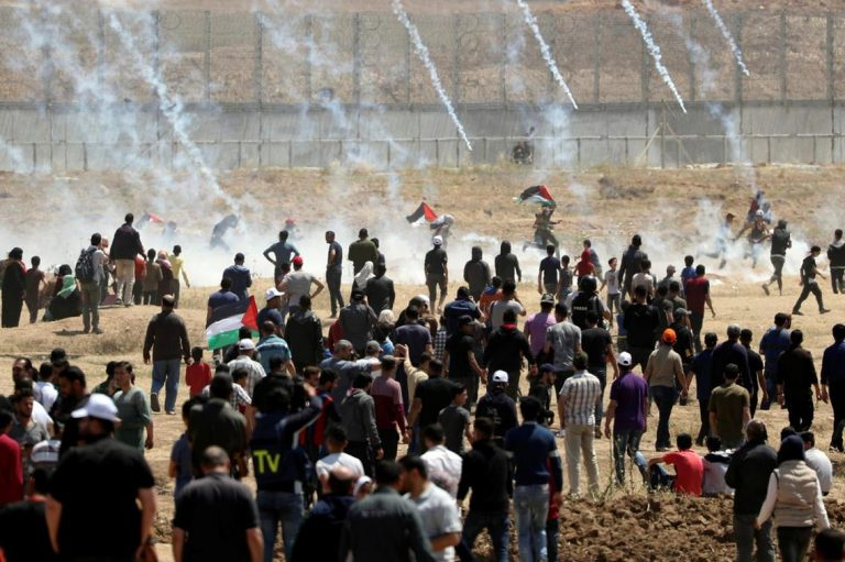Tear gas canisters fired upon protesters by Israeli forces at the Gaza border