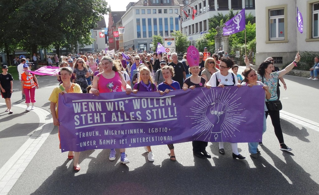 Sea of Purple: With Prams and Whistles, Swiss Women Strike for Equal Pay