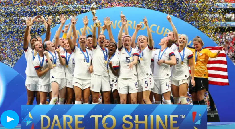 The US Women's National Football Team celebrate at the podium of the FIFA Women's World Cup