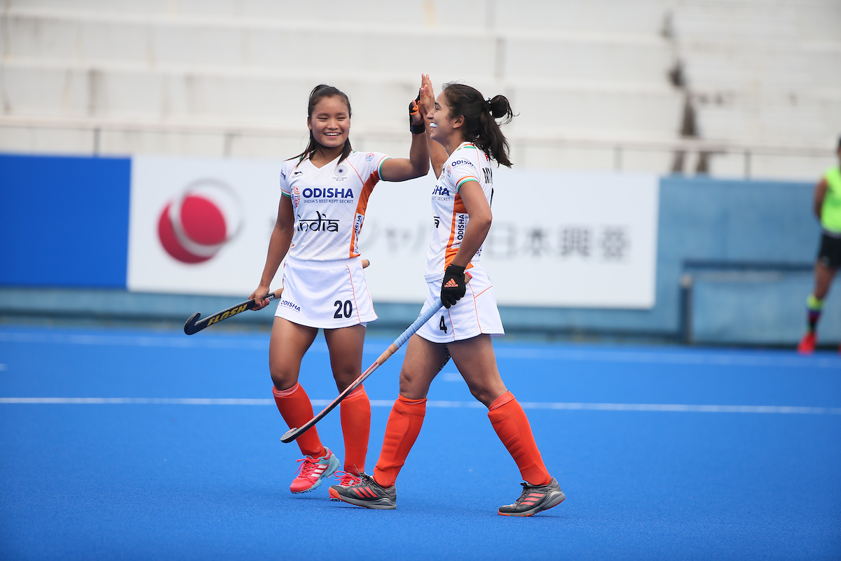 Indian women's hockey team players Lalremsiami and Monika celebrate a goal against Japan in the Olympic test event in Tokyo