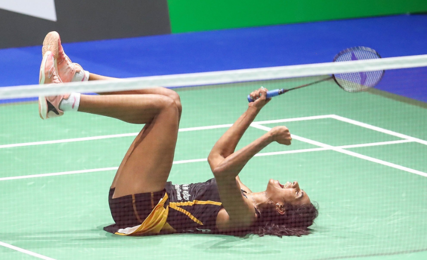 PV Sindhu celebrates after beating Nozomi Okuhara to win gold at the BWF Badminton World Championships in Basel