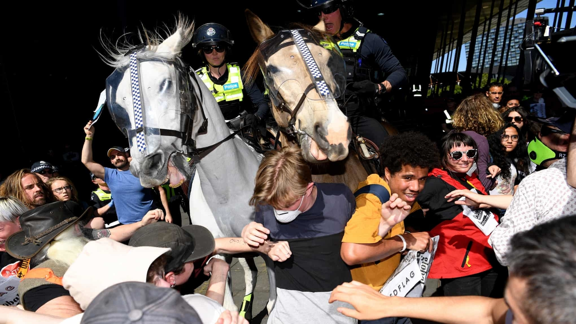 The police charged at the protesters with horses and attacked them with pepper spray.