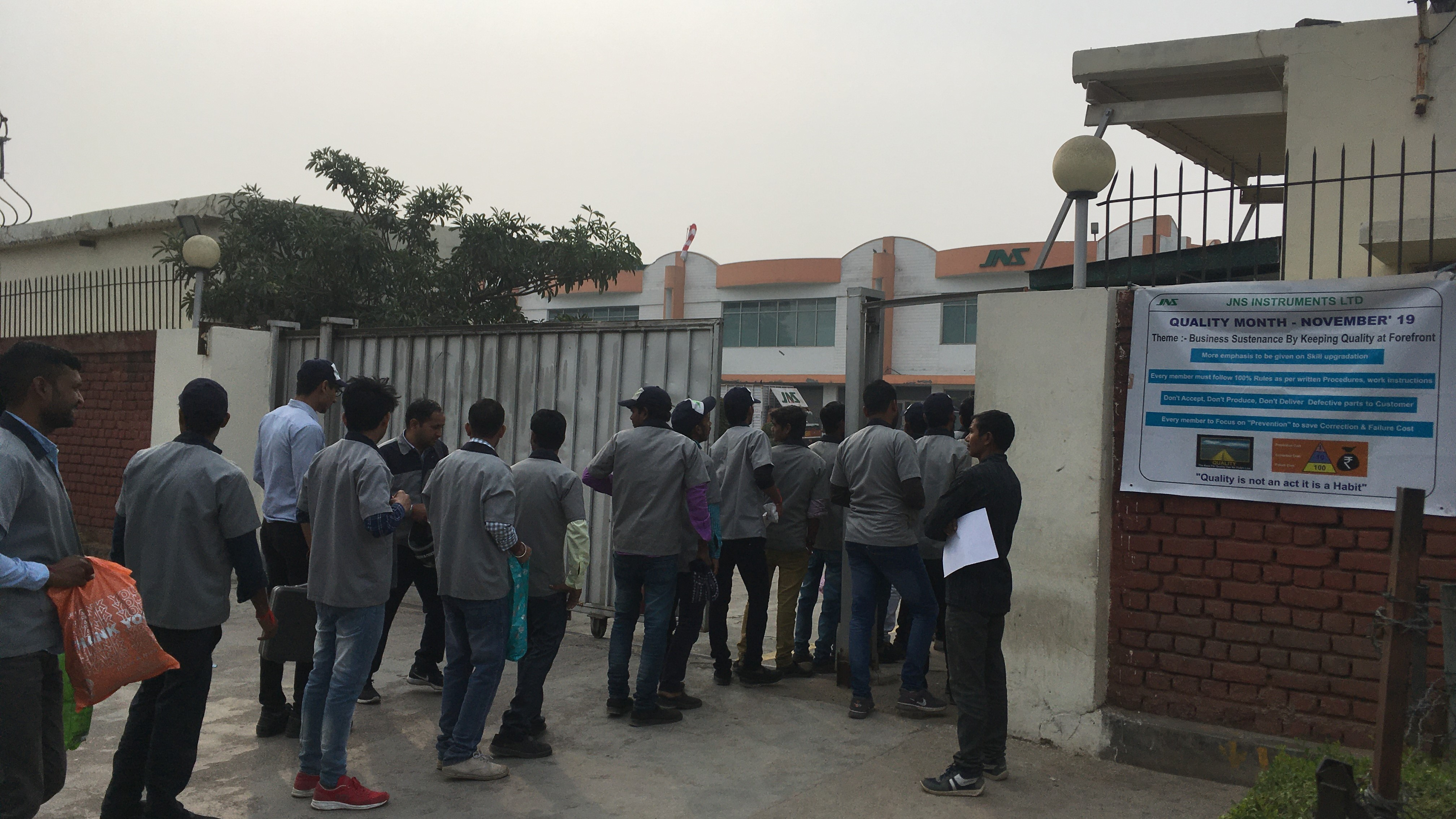 workers entering one of the manufacturing unit located in the Gurugram-Manesar industrial belt.