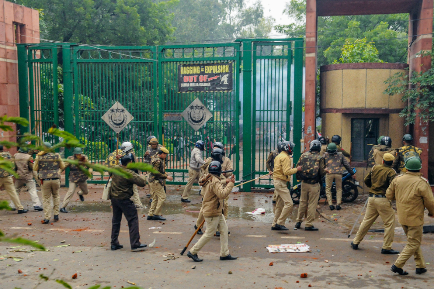 Police personnel outside the Jamia Millia Islamia University as students stage a protest against the passing of Citizenship Amendment Bill