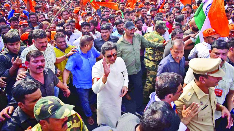 MNS chief Raj Thackeray waves as he joins party workers in the rally