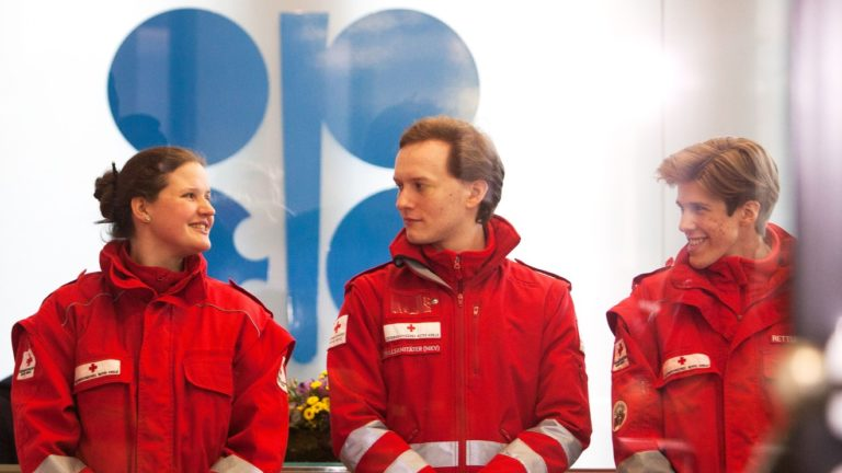 Red Cross medics waiting to check the temperature of participants at the OPEC+ meeting in Vienna, March 6, 2020 for coronavirus. None was found infected, but the meeting ended in disharmony.