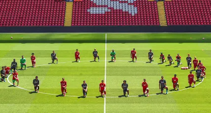 Liverpool players take the knee during training for George Floyd