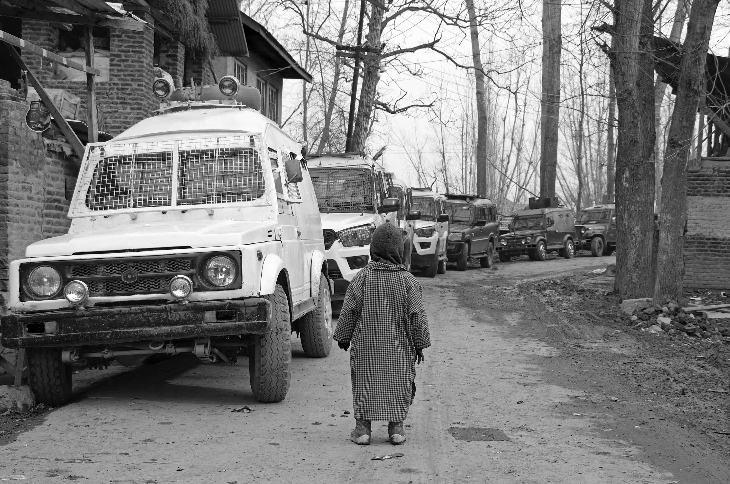 (A boy looks at armed forces' vehicles during a counter-insurgency operation in Tral area of Pulwama in South Kashmir on June 25, 2020). Picture: Kamran Yousuf/NewsClick