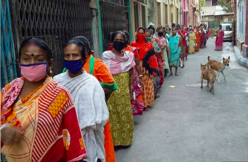 Sex workers and their families in Sonagachi, Kolkata, queue up for food rations distributed by the nonprofit New Light, on April 2, 2020.
