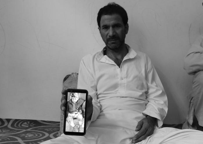 (Days after his four-year-old son was killed during a militant attack, Mohammed Yaseen Bhat displays his son Nihaan's picture at his Kulgam residence in South Kashmir on June 28, 2020) Picture: Kamran Yousuf/NewsClick