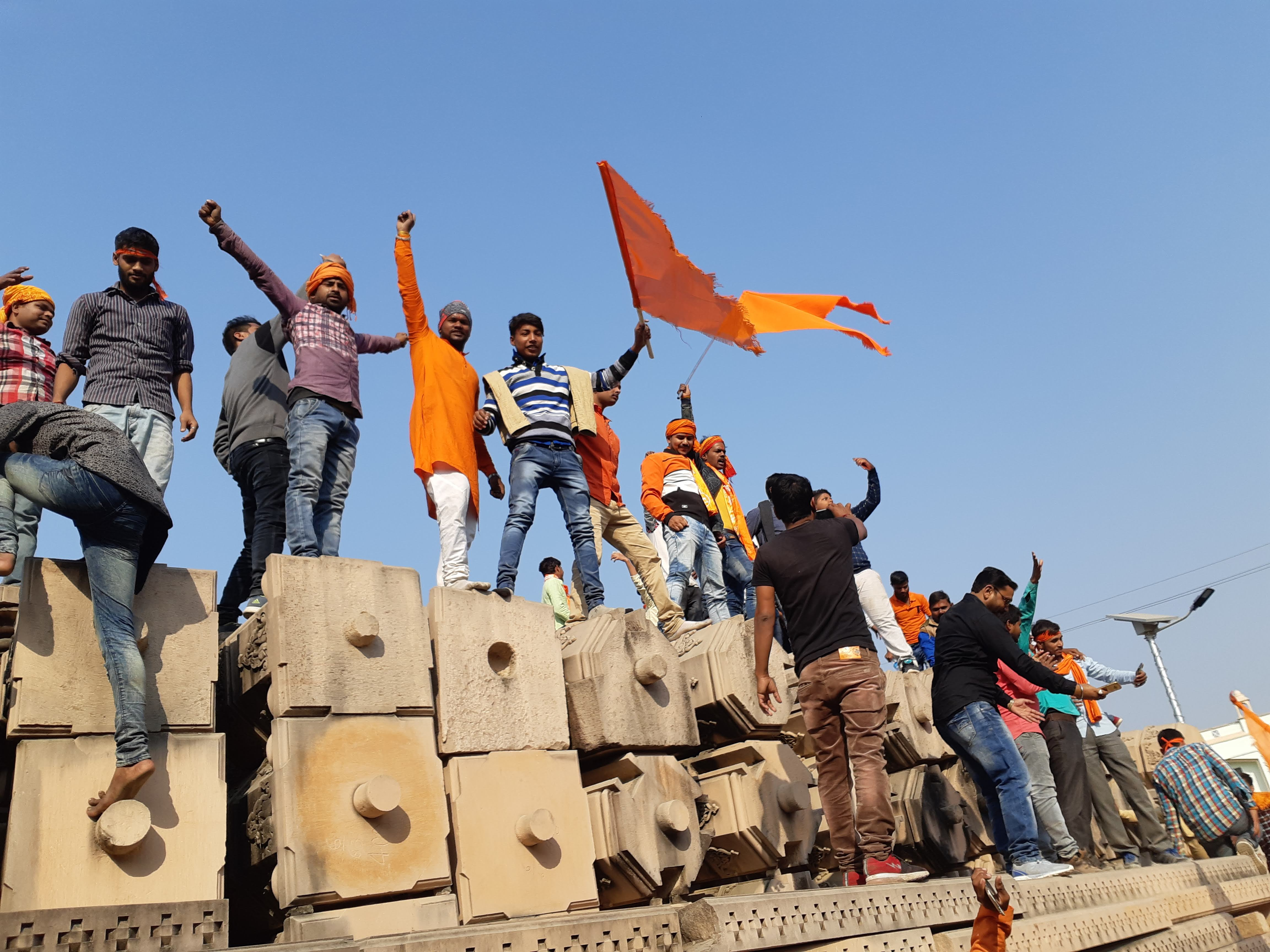 Ram%20temple%20belivers%20standing%20at%20the%20stones%20with%20saffron%20flag%20and%20chanting%20religious%20slogans%20in%20Ayodhya.%20Photo%20by%20Saurabh%20Sharm.jpg