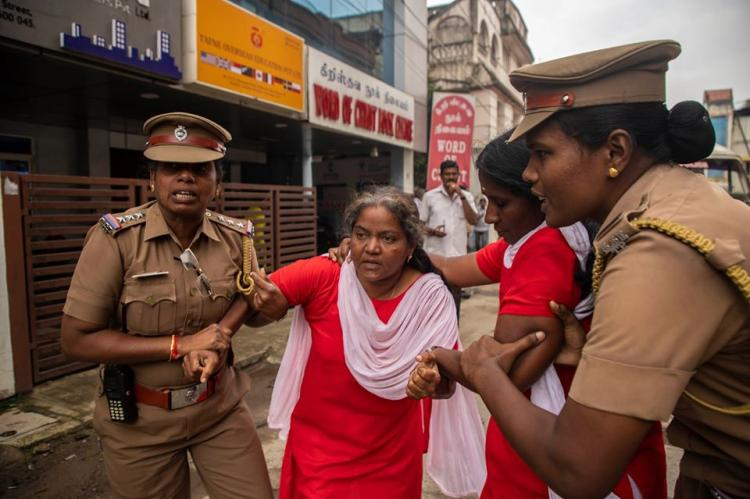 Suganthi%20is%20being%20detained%20by%20the%20police.jpg