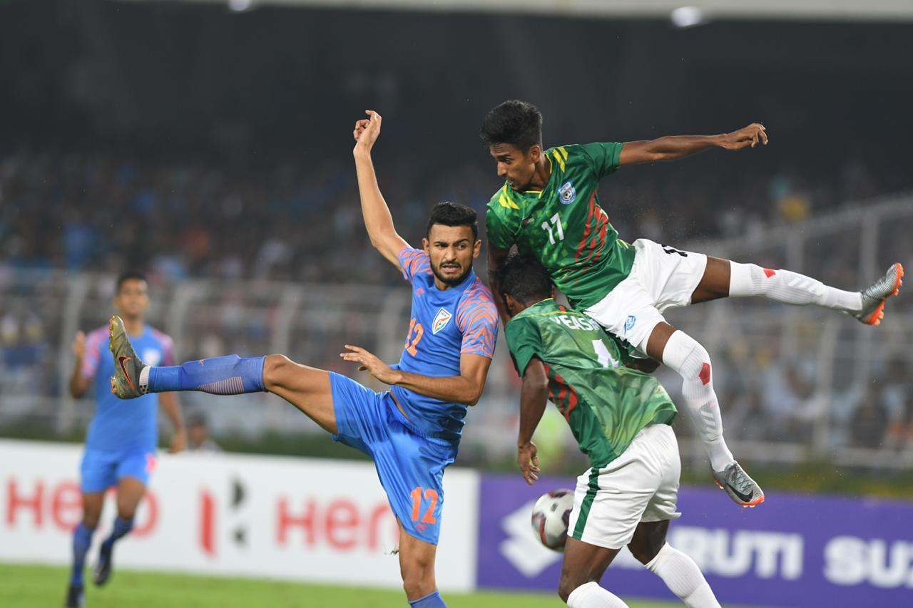 Manvir Singh of Indian football team vie for the ball with Bangladesh players in their FIFA World Cup qualifier match