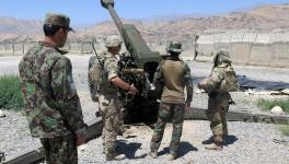 U.S. military advisers from the 1st Security Force Assistance Brigade work with Afghan soldiers at an artillery position on an Afghan National Army base in Maidan Wardak province, Afghanistan on August 6, 2018.