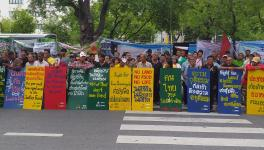 Members of various peasants' federations protest in front UN office in Bangkok.