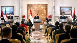 Egyptian President Abdel Fattah al-Sisi (C), flanked by Libyan commander Khalifa Haftar (R) and the Libyan Parliament speaker Aguila Saleh (L) announced a road map to end the fighting in Libya, Cairo, June 6, 2020