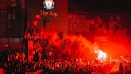 Liverpool fans celebrate the English football club's Premier League title victory at Anfield