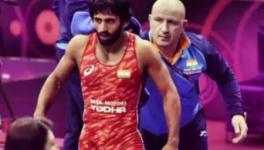 Wrestler Bajrang Punia and coach Shako Bentinidis