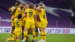 Barcelona Femeni players celebrate after beating Atletico Madrid