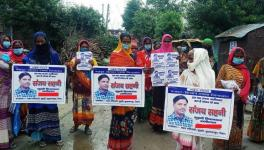 MGNREGA workers with posters of Sanjay Sahni.