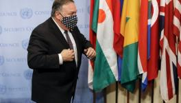 US Secretary of State Mike Pompeo wears a facemask as he departs after meeting with UN Security Council members regarding restoration of sanctions against Iran, United Nations headquarters, New York, August 20, 2020.