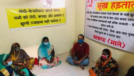 Residents of Delhi's Wazirpur slum sitting on hunger strike against the Supreme Court.
