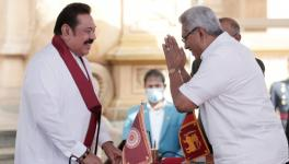 Sri Lankan President Gotabaya Rajapaksa (R) greeting the newly-elected Prime Minister Mahinda Rajapaksa (L) at the swearing-in ceremony at Kelaniya Buddhist temple in Colombo, Aug 9, 2020