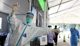 A medical worker guides people at a nucleic acid testing site in Tongzhou District of Beijing, capital of China, June 22, 2020. China contained the spread of COVID-19 to other provinces through mass testing, early lockdown measures and an overall focus on saving people's lives. Photo: Xinhua/Zhang Chenlin.