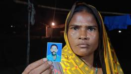 Rekha Devi, showing picture of her dead husband whose life was claimed by illicit liquor on January 1,2020