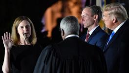 Amy Coney Barrett takes her first oath as an associate justice of the Supreme Court, hours after her controversial confirmation by the Senate (Photo: Nicholas Kamm/AFP)