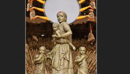 Sculpted tableau of Durga and her children as a migrant worker family