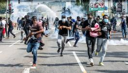 Nigerian protesters being chased by the police. File Photo (Business Day)