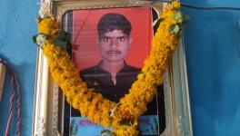 Garlanded photo of Chetan Alhat