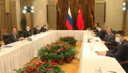 State Councilor & Foreign Minister Wang Yi (second from right) and Russian FM Sergey Lavrov (L) held talks in Guilin, March 23, 2021