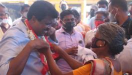 PP Chitharanjan being welcomed by a woman from the fishing community during the march.