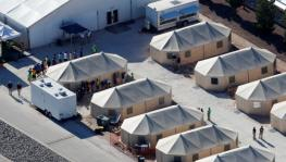 "Immigrant children now housed in a tent encampment under the new ""zero tolerance"" policy by the Trump administration are shown walking in single file at the facility near the Mexican border in Tornillo, Texas, U.S. June 19, 2018."