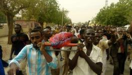Protesters carry those killed during the protests in Atbara, River Nile State.
